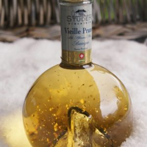 Destillerie Studer Goldflitter im Schnee