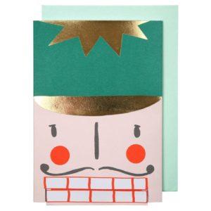 Eine lustige mechanische Karte Merry Christmas als Nussknackerkopf.
